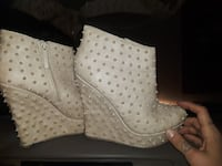 pair of beige studded platform side-zip shoes