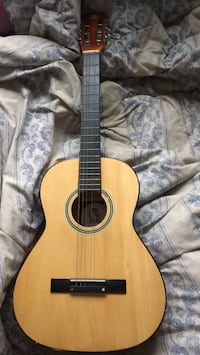 brown and black classical guitar 546 km