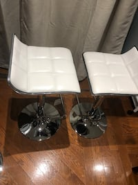 Two white leather  barstool see pictures low 22 high 30 inches $110 both Toronto, M9V 4T4