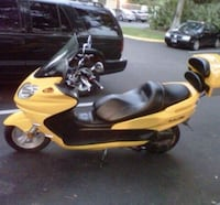 yellow and black motor scooter