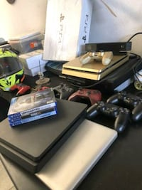 black Sony PS3 slim console with controllers and game cases 45 mi
