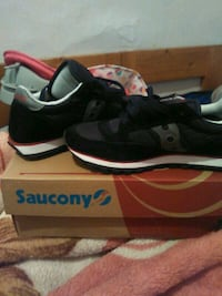 pair of black and red gray saucony sneakers Jersey City, 07306