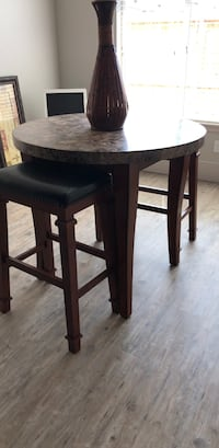 round brown wooden table with four chairs dining set Lubbock, 79424