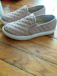 pair of quilted nude-colored slip-on shoes