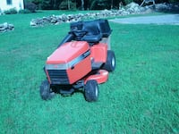 red and black ride on lawn mower