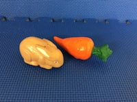 two brown rabbit and carrot toy's