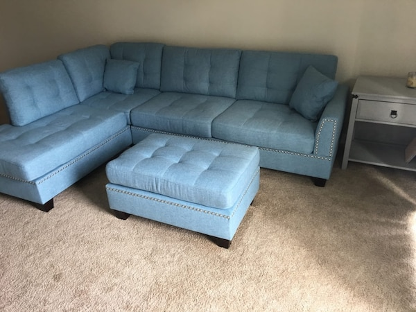 Brand new light blue sectional sofa with ottoman