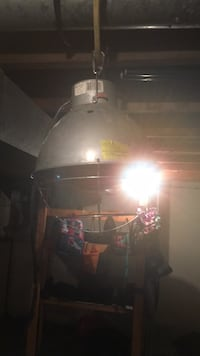 Heat lamp with bulb. Good for growing or heat lamp for outside animals. Make offer or trade 1295 km