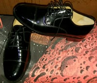 pair of black leather dress shoes Wichita, 67218