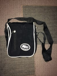 black and white Lacoste sling bag