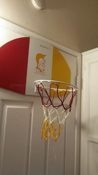 red, white and yellow basketball hoop California, 91352