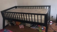 black wooden crib with mattress it from the top of a bunkbed.  Bakersfield, 93306