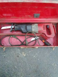 red and black Milwaukee Sawzall reciprocating saw kit