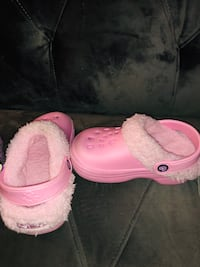 pair of pink rubber clogs 309 mi