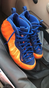 pair of blue-and-orange Nike Foamposite shoes