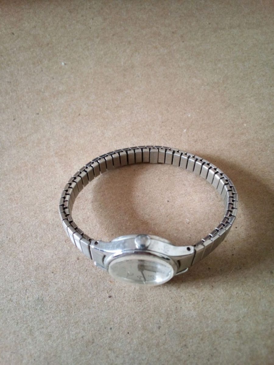 round silver and black analog watch for sale  Avon