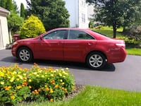 red 4 door 2009 Toyota Camry Silver Spring, 20907