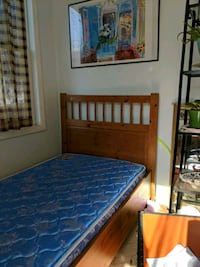 brown wooden bed frame and blue mattress Falls Church, 22043