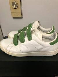 pair of white-and-green adidas sneakers 3688 km