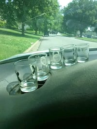 four clear glass candle holders Conover