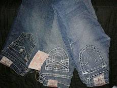 three blue True Religion jeans