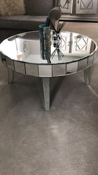 round clear glass-top table with gray steel base Oxted, RH8