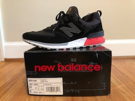 black and red new balance running shoe