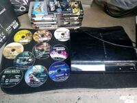 black Sony PS3 super slim console with game cases Fresno, 93726