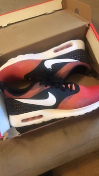 Pair of red nike running shoes with box St. Louis, 63112