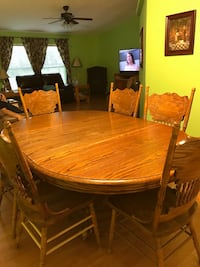 oval brown wooden table with six chairs dining set Mooringsport, 71060