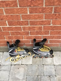 two pairs of black and yellow inline skates Kitchener, N2N 2A1