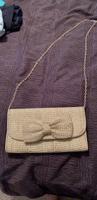 Gold and straw clutch purse.