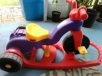 toddler's red and purple ride on toy