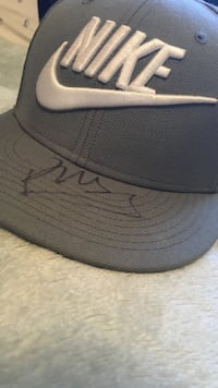 Official Nike True Fitted signed by Singer/Songwriter Russ Diemon