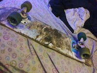 skateboard with royal paint splater trucks and vis