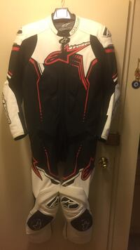 Black, red, and white Alpinestar overallsuit