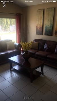 Real leather sofa , loveseat and table Sterling Heights, 48310