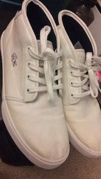 Pair of white Lacoste low-top sneakers