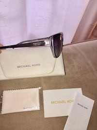 Authentic Michael Kors sunglasses in mint condition. No scratches, comes with case, eye cloth hasn't even been open. Practically brand new. Bought from the sun glass hut. Woodstock, N4S 7C8