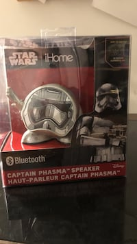 gray and white Star Wars iHome Captain phasma speaker with box