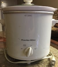 White and black Proctor Silex rice cooker