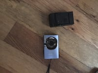 gray canon point and shoot camera with battery charger