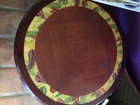 Round brown wooden pedestal table 2178 mi