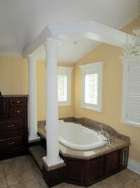 Jacuzzi Tub with Granite Top and Faucet null