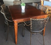 rectangular brown wooden table with four chairs dining set Spokane Valley
