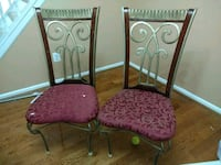 two black metal framed red padded chairs Centreville