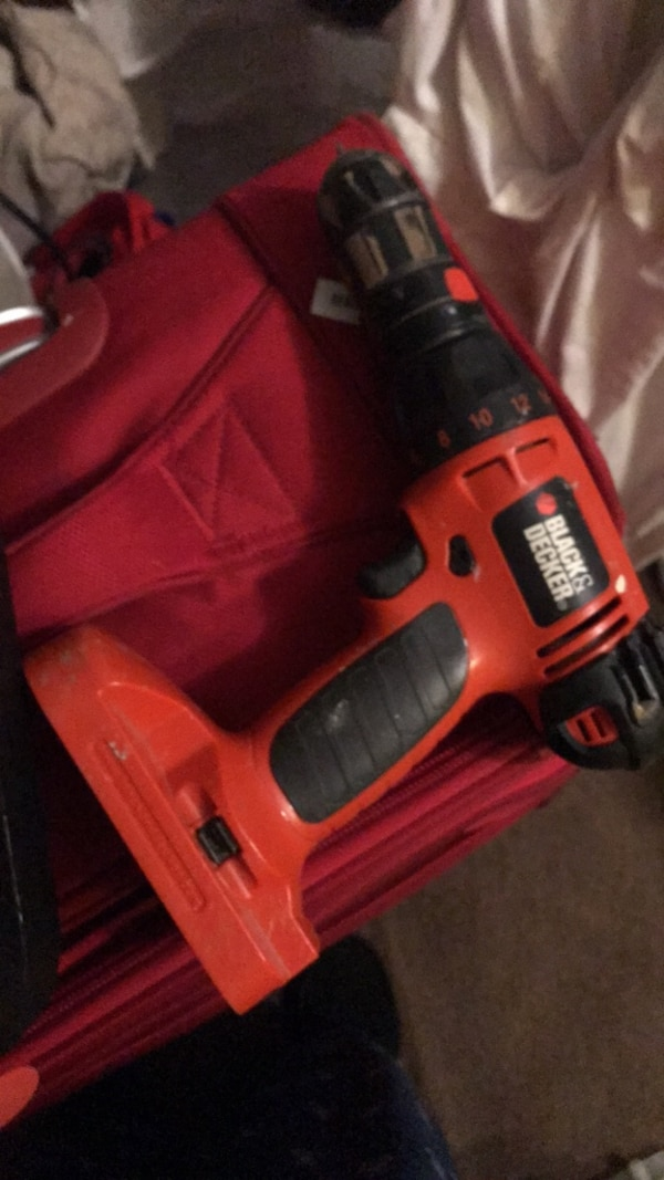 red and black Black & Decker cordless power drill