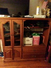 brown wooden TV hutch with flat screen television Tallahassee