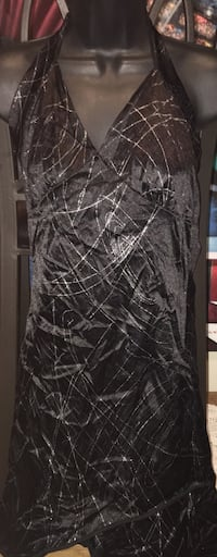 Women's L mini black dress in good condition located off lake mead and jones area asking $3