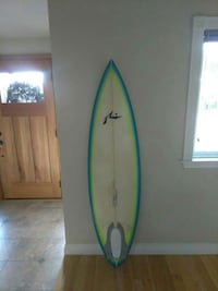 beige and blue surf board